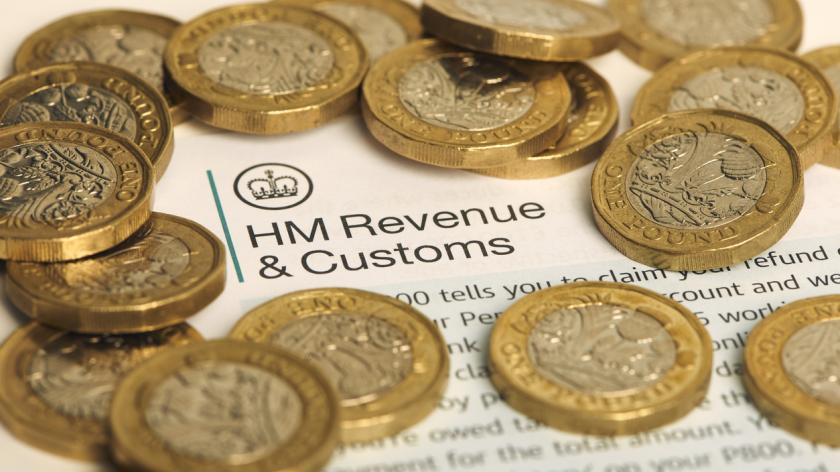Money surrounding a HMRC letter head