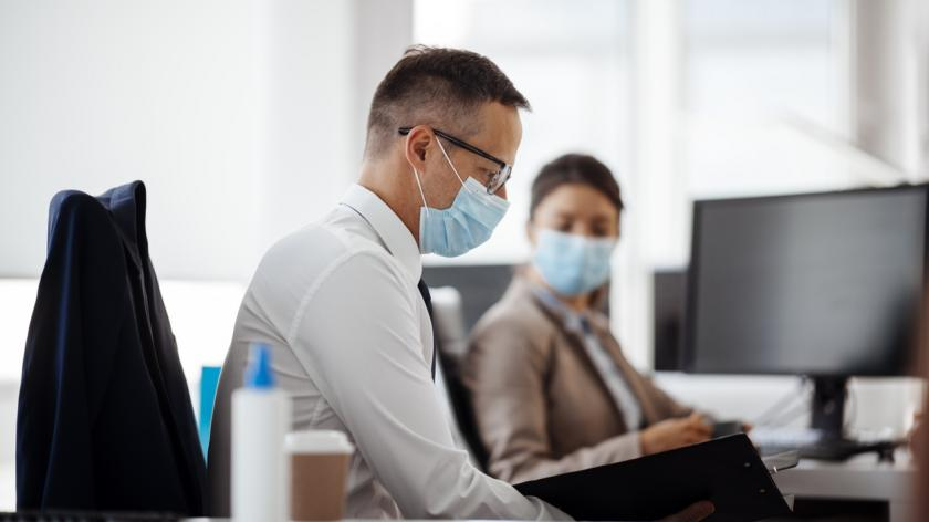 returning to the office in a face mask