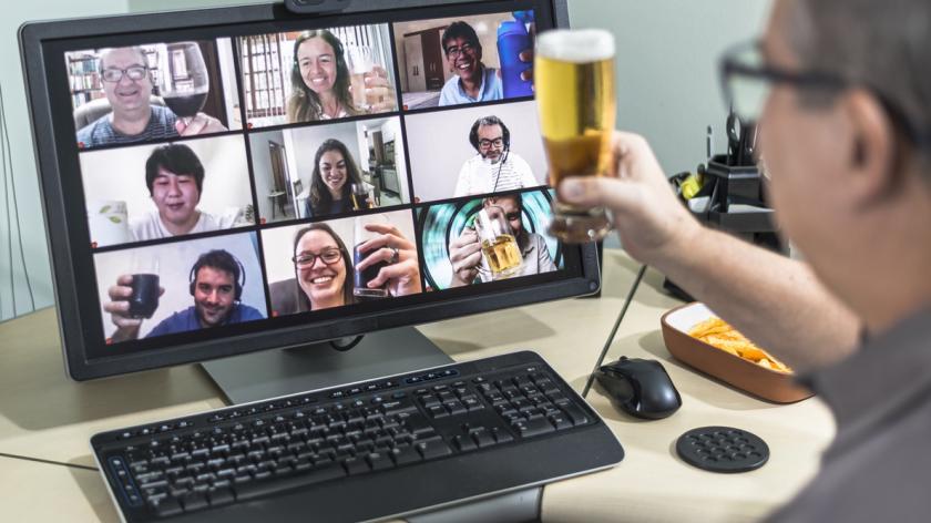 A work team having a social drink