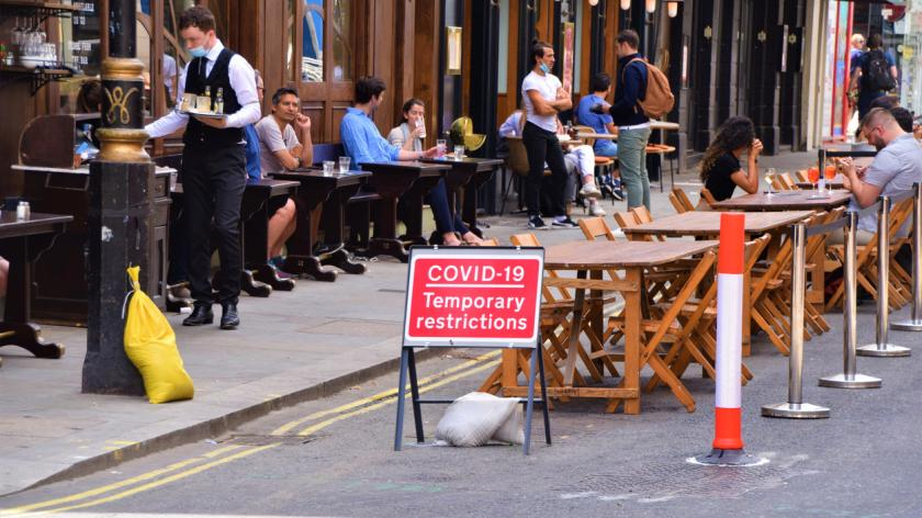 Social distancing cafe and restaurant temporary street seating in Old Compton Street, Soho