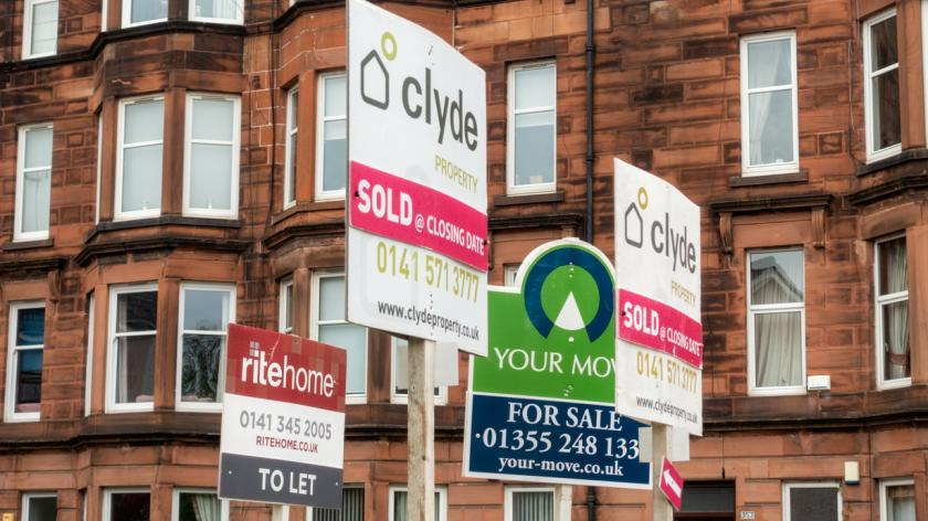 A group of property signs in the Cathcart district of Glasgow's Southside