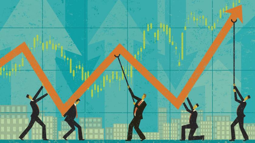 Businessman holding up profits during tough economic times.