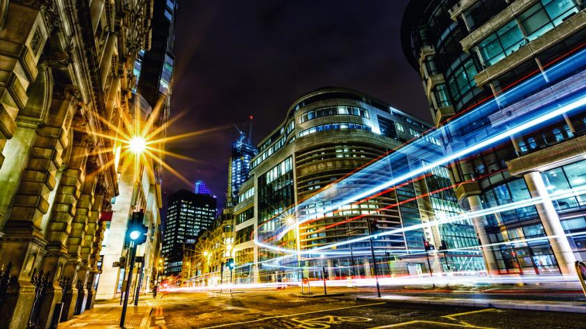 Light trails in City of London at night showing changing.