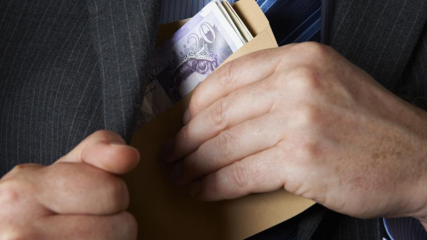 Man hiding cash