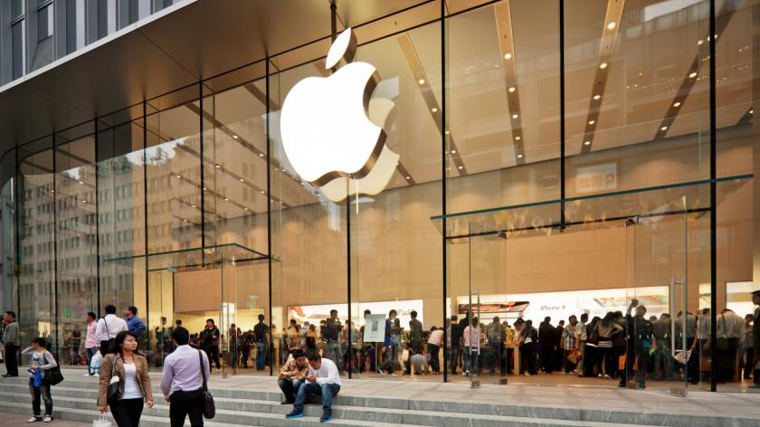 Glass entrance to the Apple Store at Nanjing road opened on the September 23, 2011. Many people inside and outside the shop.