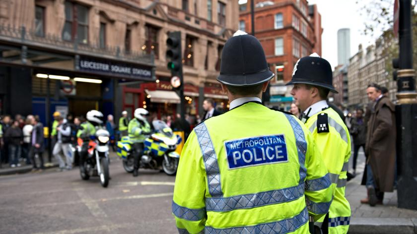 Two London policemen standing by the roadside during a demonstration being held in Central London.