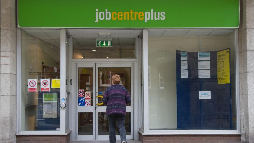 Unemployment: Woman walks towards door of Job Centre Plus