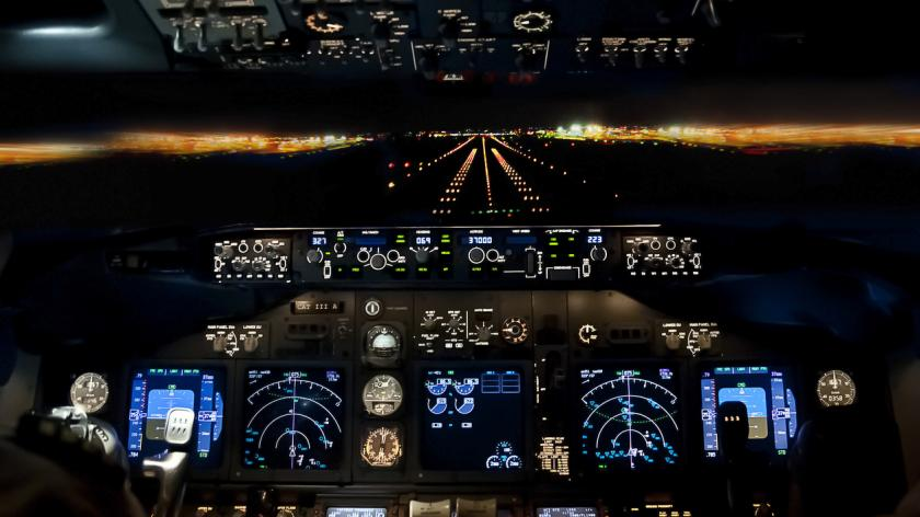 A pilot's cockpit - Final approach at night