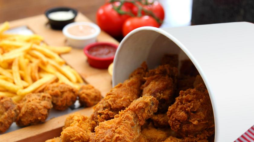 Finger Licking Chicken Fried chicken bucket composition stock photo