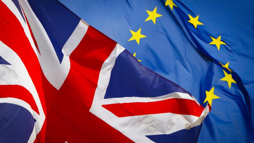A picture of the UK and EU flags