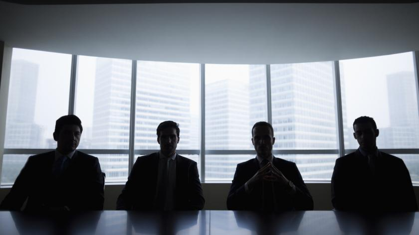 Silhouette row of businessmen