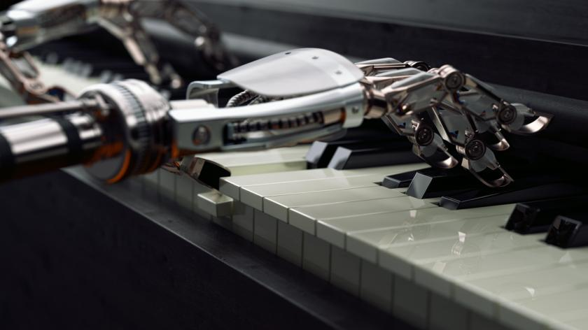 Robot hands playing piano