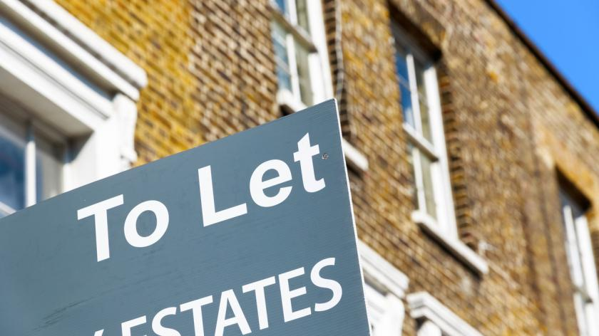 To Let property agency sign posted outside English terraced houses