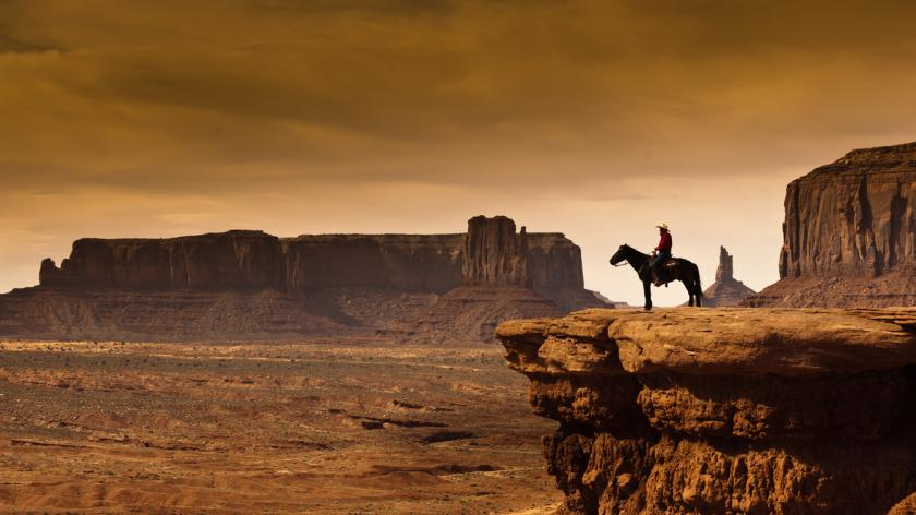 Western cowboy Horseback at Monument Valley Tribal Park