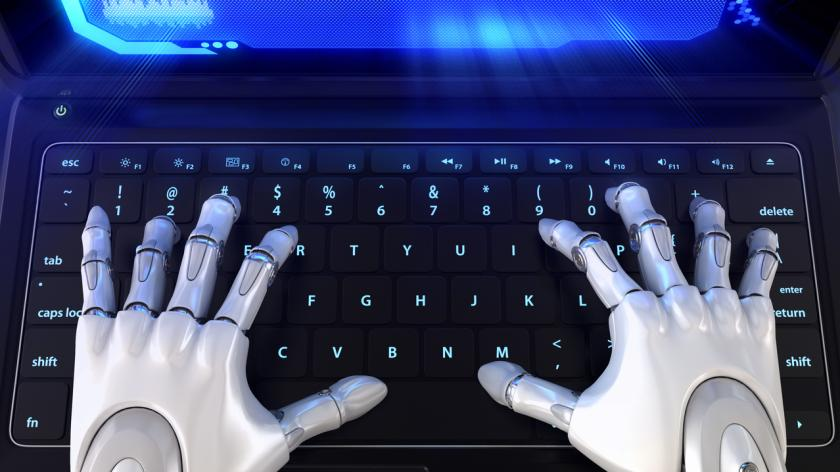 Robot hands typing on keyboard