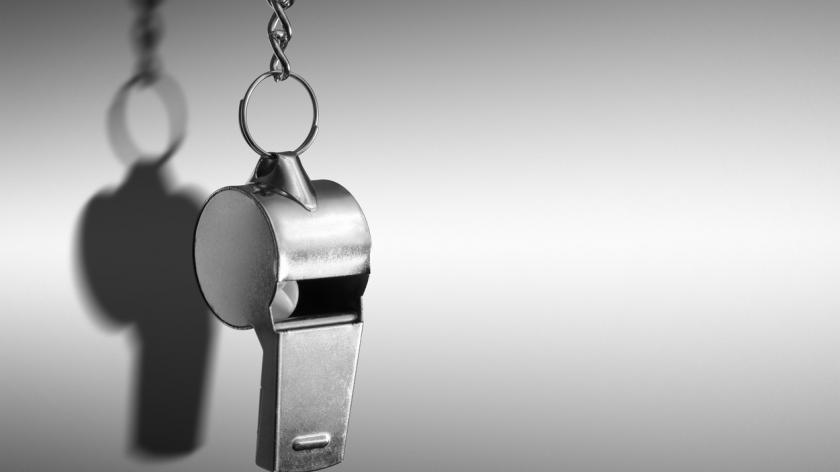 Hanging metal whistle closeup