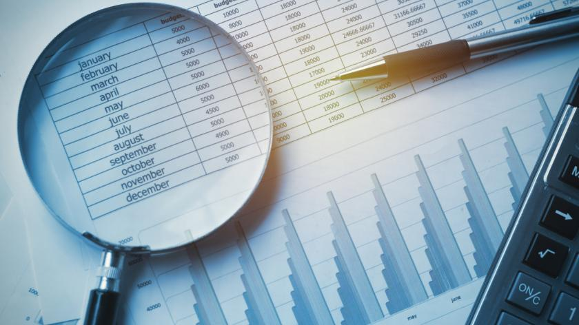 Business documents accounting with calculator, pen and magnifying glass
