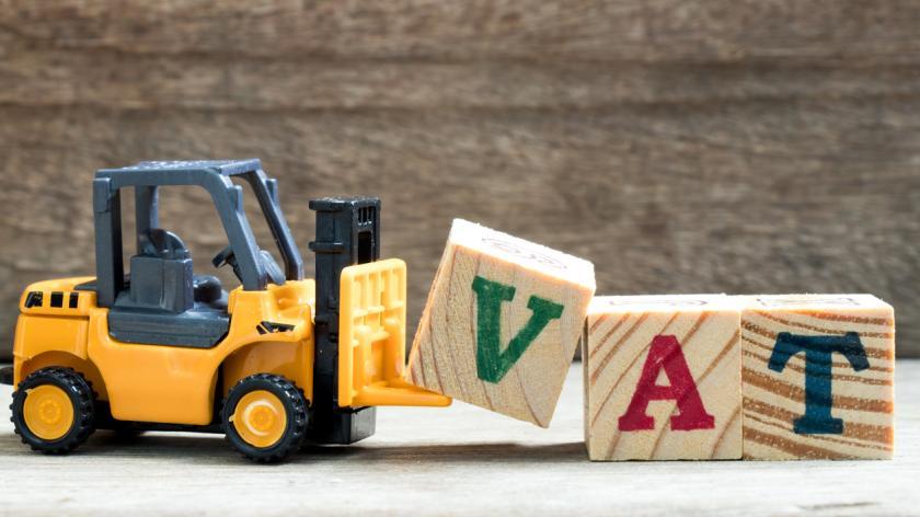 Abolish VAT: Toy plastic forklift holding VAT
