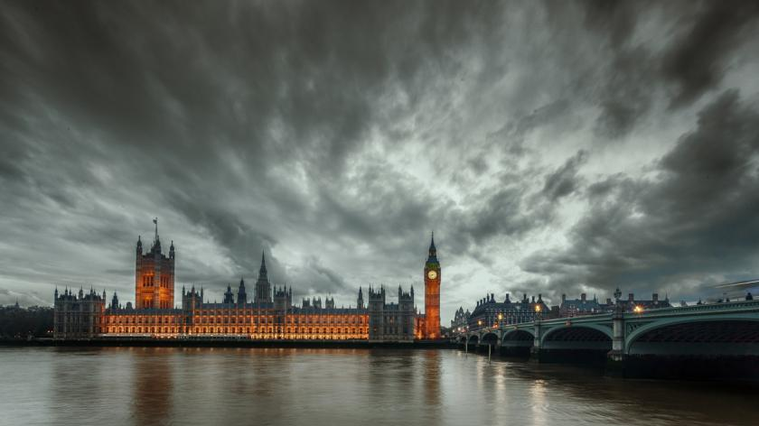 Storm brewing in Westminster Parliament and Big Ben with storm clouds after sunset, London, United Kingdom