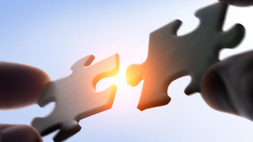 A jigsaw image depicting Mergers and acqusition