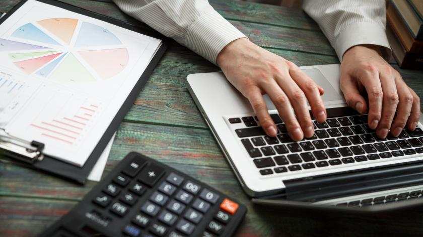 Business man calculate about cost and doing finance at office