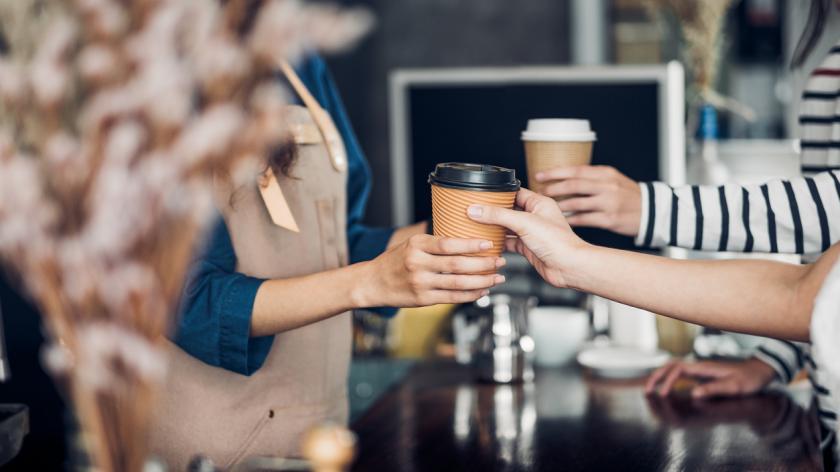 Barista serving take away coffee