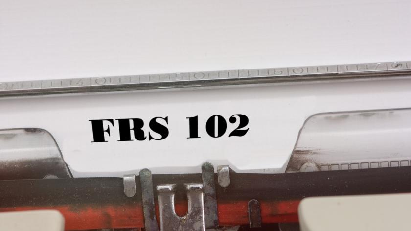 typewriter with FRS 102 on the page