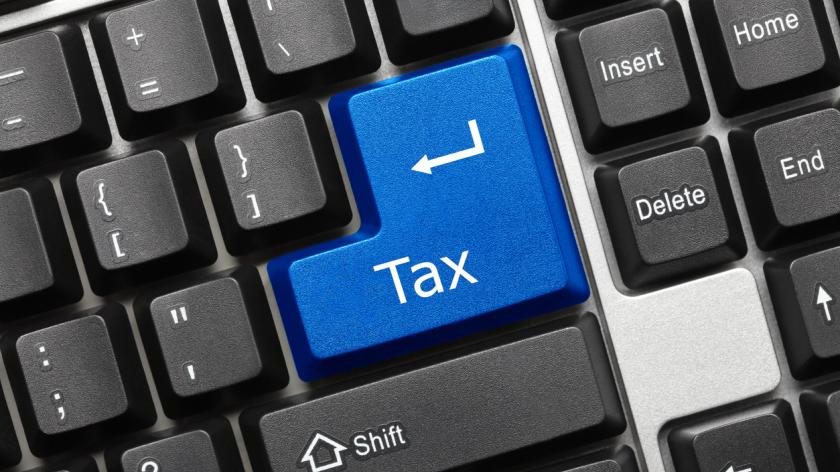 Conceptual keyboard blue tax key