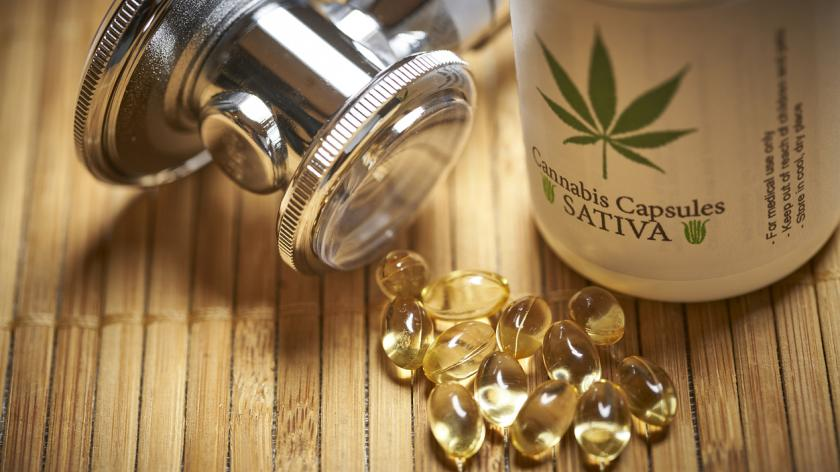 Recreational medical marijuana and stethoscope cannabis bottle with pills and gels