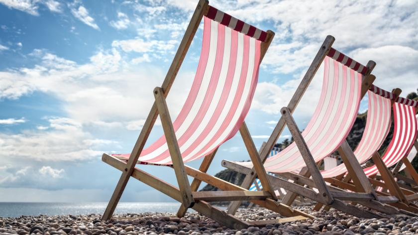 Deck chairs on the beach at the seaside