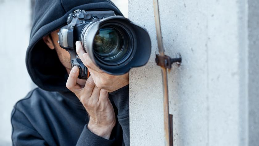 Spy with long lense