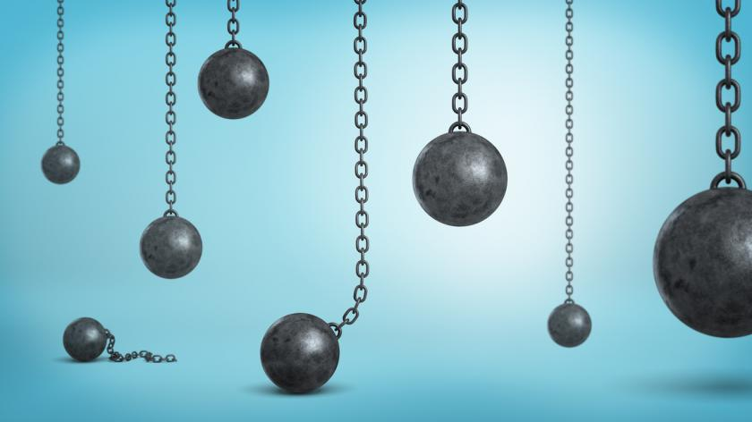black iron wrecking balls hanging on chains