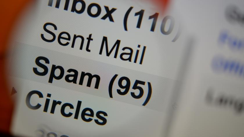 Magnifying glass showing a spam folder