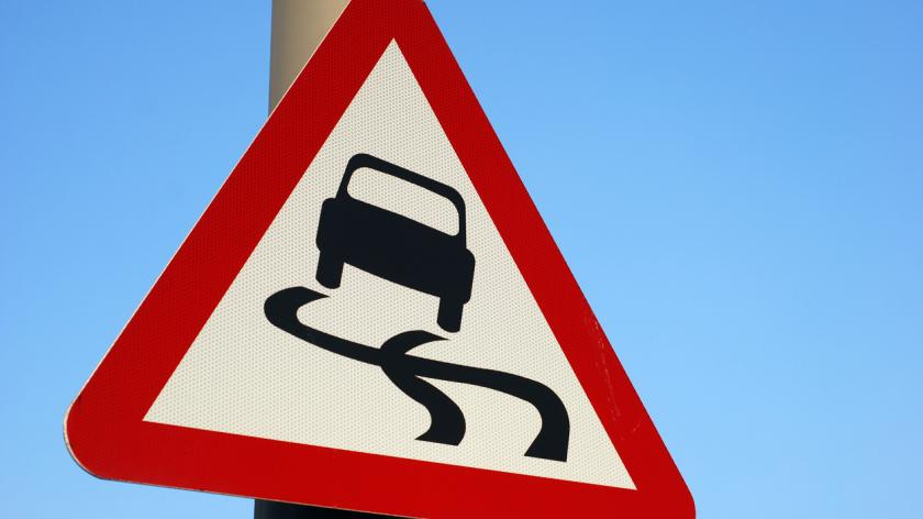 Skidding car roadsign
