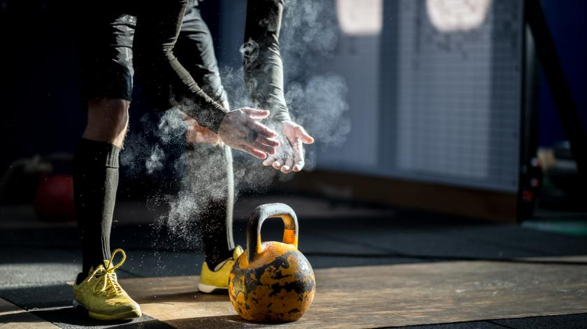 Man ready to exercise with kettle bell