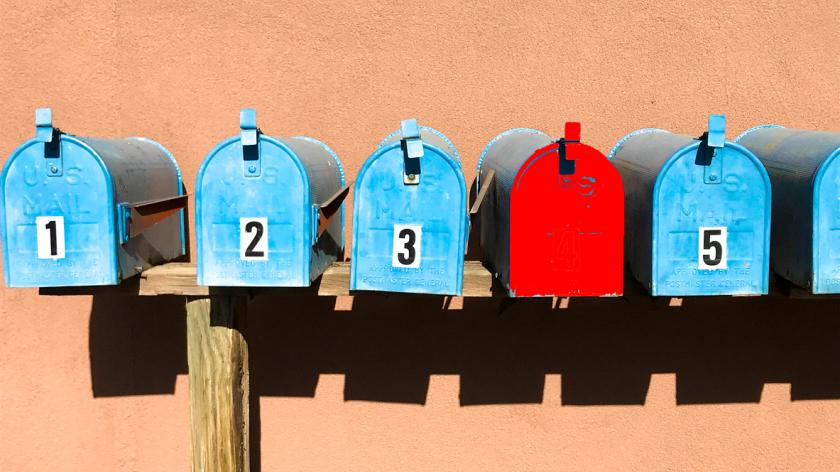 Stand Out: Line of Rural Mailboxes with One Red