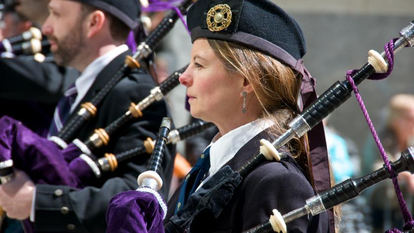 Female bagpiper at Tartan Day Parade