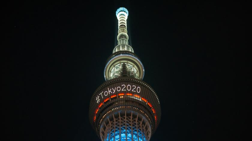 he skytree tower is illuminated at night announcing the olympics of Tokyo 2020