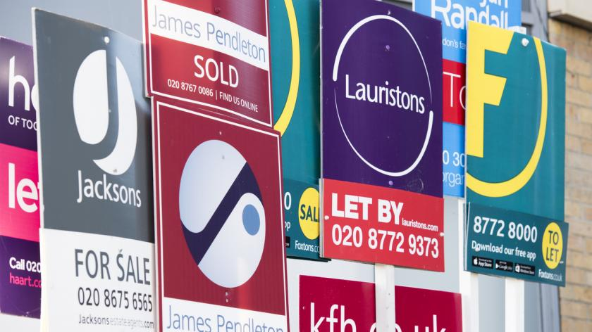 Cluster of Estate Agency advertising boards in London
