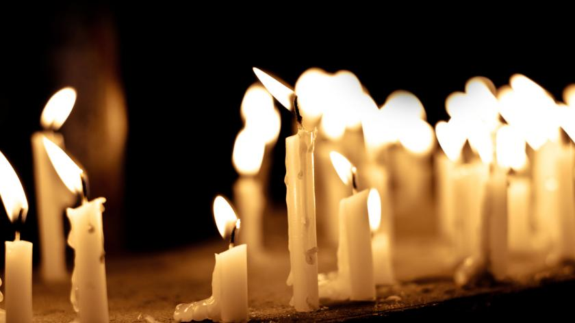 Group of lighting candles in black background