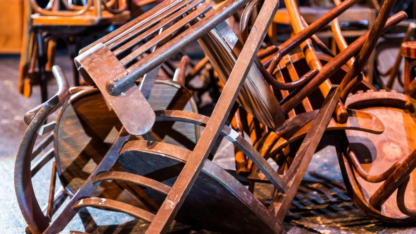 A pile of wooden chairs