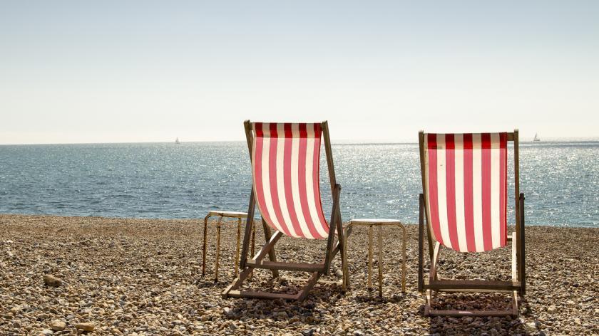 Pair of deckchairs on a beach in summer