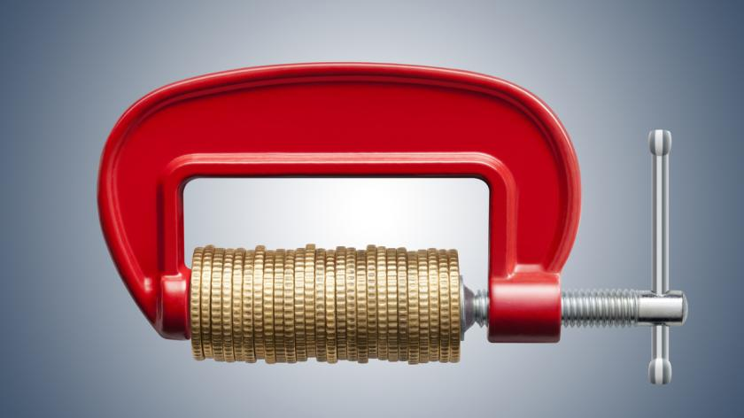 Money squeeze. Clamp with coins