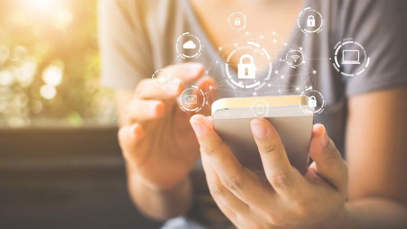 smartphone with icon graphic cyber security network of connected devices and personal data information