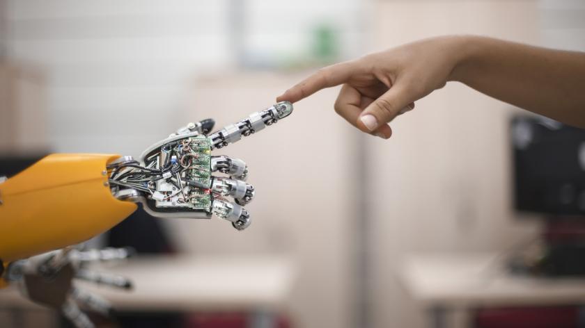 hand touching a robot