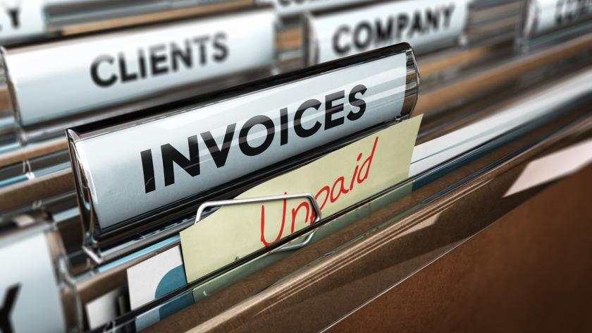 Unpaid invoices in a filing cabinet