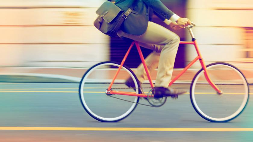Speeding through the streets on a bicycle