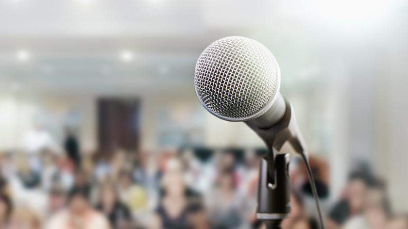 Microphone awaits public speaker at seminar