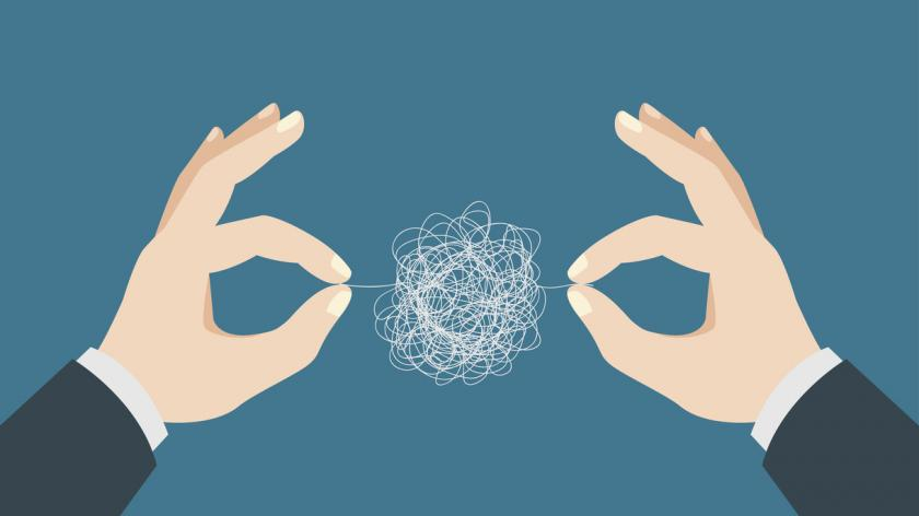 Man hands trying to untangle the tangled thread