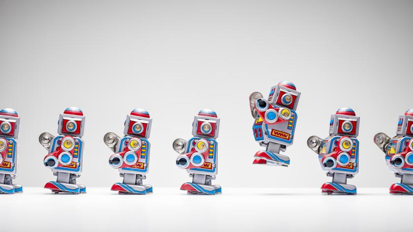 Retro tin toy robots standing in a row